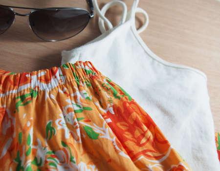 informal clothing: Short pants, white t-shirt, sunglasses Stock Photo