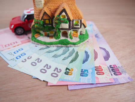 current account: Banknotes money, earn and save for a house, a car plan concept