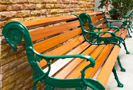 timber bench seat: Wooden park bench in the garden Stock Photo