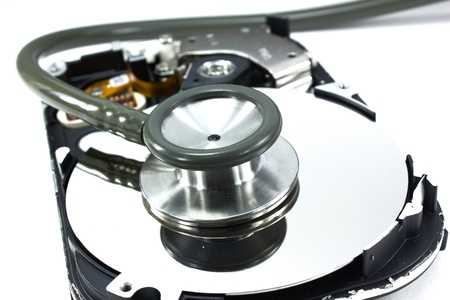Computer hdd and hand with stethoscope - technology background photo
