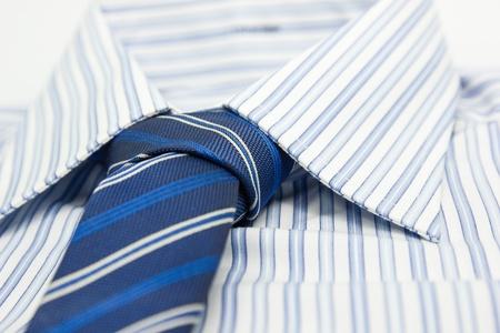 blue and black shirts isolated on white photo