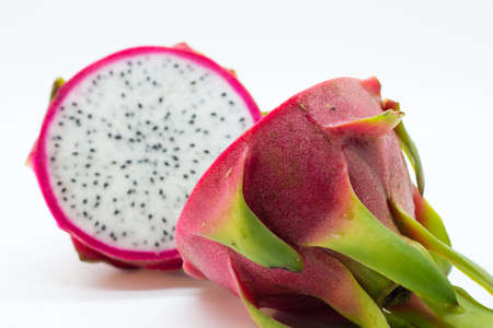 dragonfruit: Whole dragonfruit cut in half from the back with a blurry front