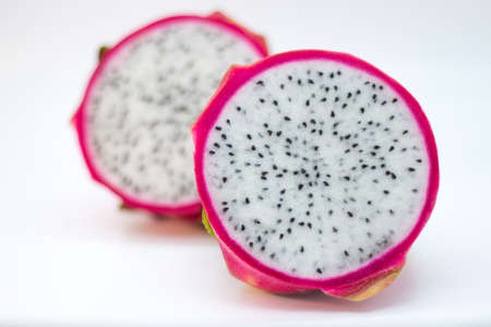 dragonfruit: Whole dragonfruit cut in half from the front with a blurry back