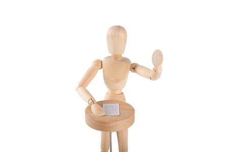 delivers: Wooden puppet delivers a speech on white background Stock Photo
