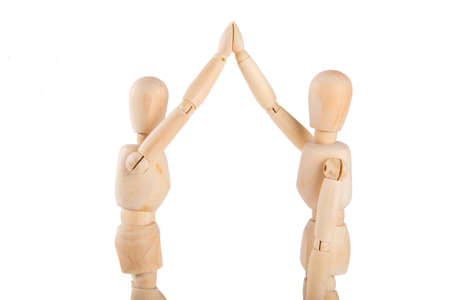 puppets: Two wooden puppets exchanging high five on white background