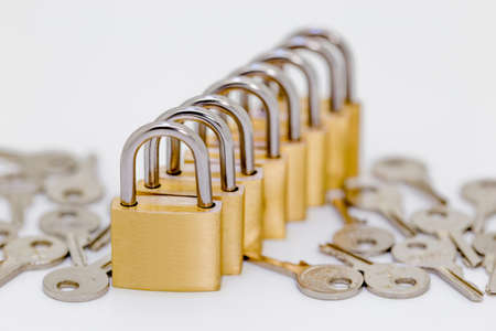 lock: Several locks in a row with keys on white background Stock Photo