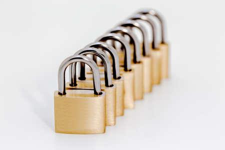 the lock: Row of locks on white background