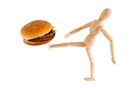 Puppet kicks burger away on white background