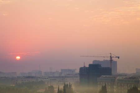 hazy: Sunrise in Shanghai on hazy day with smog