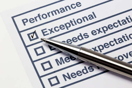 tick: Performance evaluation paper with pen and tick marks