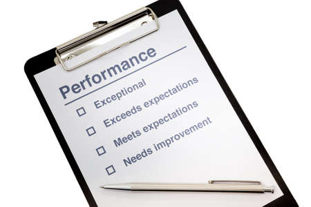 business performance: Performance evaluation paper with pen and tick marks on clipboard