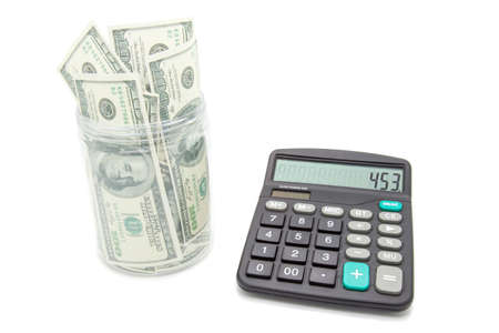 money jar: Money jar with dollar and calculator on white