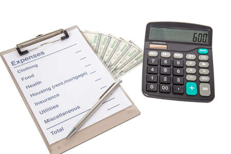 expenses: List of common expenses, dollar notes and a calculator Stock Photo
