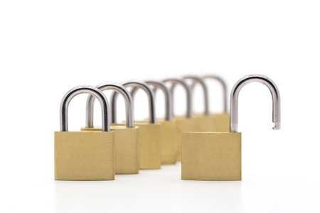 security safety: Row of padlocks on white background with one lock opened