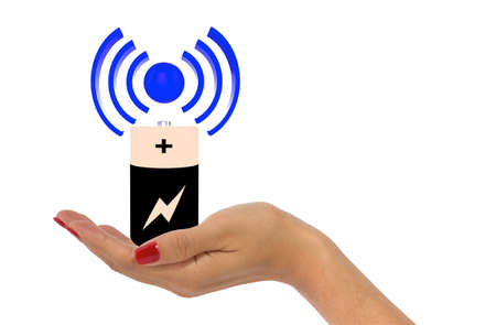 wireless icon: Womans hand with red fingernails holding wireless charging icon