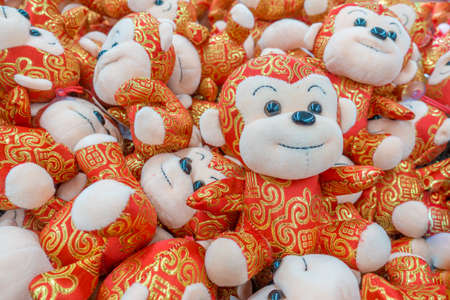 lunar new year: Pile of Chinese new year monkeys in gold and red