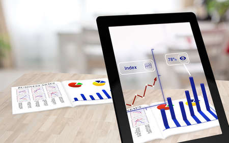 enhanced: Augmented reality business magazine seen through a tablet with enhanced charts