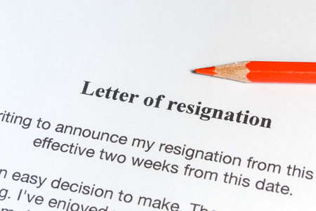 resignation: Letter of resignation and a red pencil