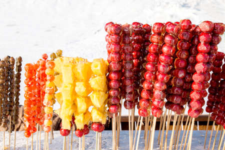 coated: Frozen sugar coated fruits with icy background in winter Stock Photo