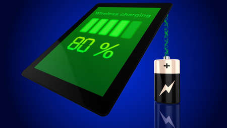 wirelessly: Wireless charging concept with a tablet being charged by a battery wirelessly