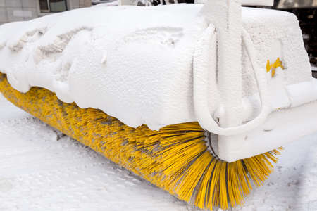 outside machines: Snow remover vehicle with yellow brush covered in ice and snow