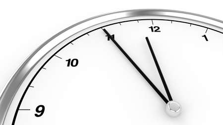 urgency: Metal clock shows five minutes before twelve Stock Photo