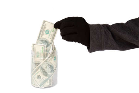 white piggy bank: Hand with black glove stealing money from the cookie jar