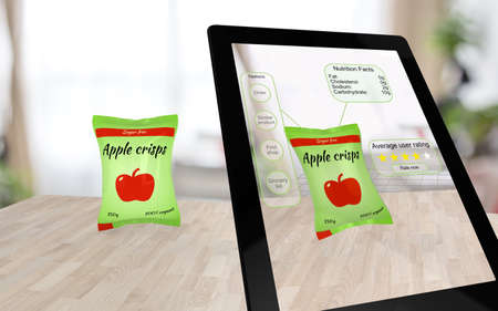 VIRTUAL REALITY: Augmented reality apple crisps on a table scanned by a tablet with inquiry options