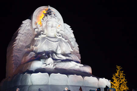 fertility goddess: Harbin,China 01202016 Guanyin the goddess of fertility at night  as a snow sculpture at the ice festival on sun island