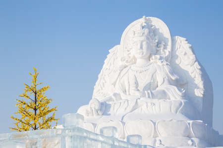 fertility goddess: Harbin,China 01202016 Guanyin the goddess of fertility as a snow sculpture at the ice festival on sun island Editorial