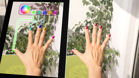 fingernail: Woman adjusting her fingernail color with a tablet augmented reality concept