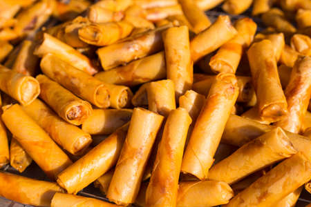 heap of role: Pile of fried Malaysian spring roles on a local market in Malaysia
