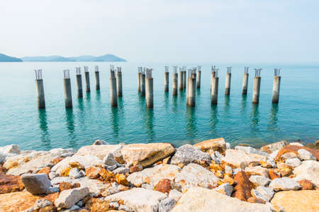 langkawi island: Concrete piles with iron from an unfinished building in the blue waters around Langkawi island Malaysia