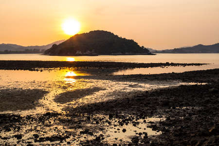 langkawi island: Sunset on Langkawi island in Malaysia at low tide with stones and water