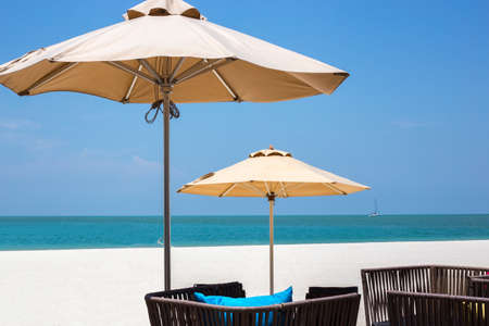 langkawi island: Two umbrellas and straw seats at a beach on Langkawi island in Malaysia