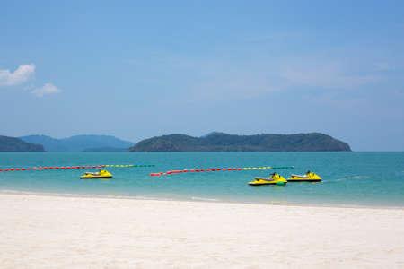 langkawi island: Three yellow jet ski in the water on Langkawi island Malaysia