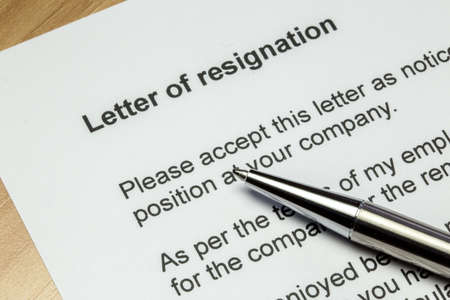 resignation: Letter of resignation closeup with silver pen Stock Photo