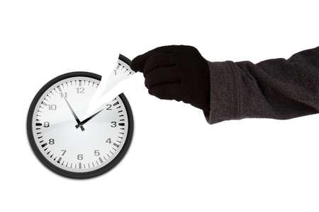 Arm mit schwarzen Handschuh ein Stück einer Uhr Zeit Dieb Konzept stehlen Standard-Bild