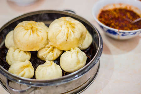 specialty: Silver steamer with different sized of  Chinese baozi- a filled bread specialty from China