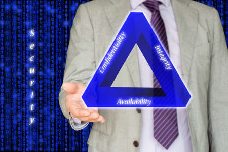 The basic concept of information security the CIA triangle illustrated by an IT expert on blue digital stream background Stock Photo