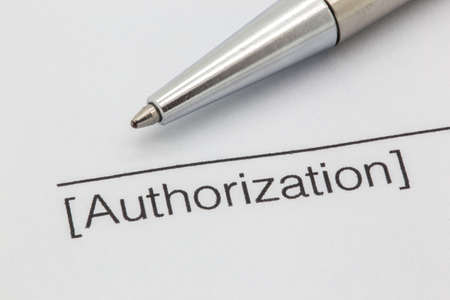 Close up of a contract with a line and the word authorization here and a silver pen Reklamní fotografie