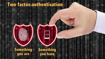 Hand putting together two security shields revealing red datastreams showing the phrase something you are and have fingerprint and mobile two factor authentication concept