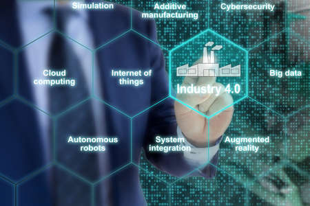 industry: Industry 4.0 concept illustration infographic hexagon grid explanation of main components with hand of an IT expert pointing to a factory icon Stock Photo