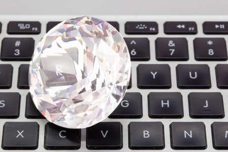 Huge diamond on a computer keyboard get rich online concept