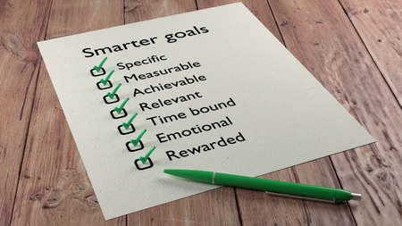 rewarded: Advanced goal setting concept with the words specific measurable achievable relevant time bound emotional and rewarded on a paper checklist and a green ball pen 3D illustration