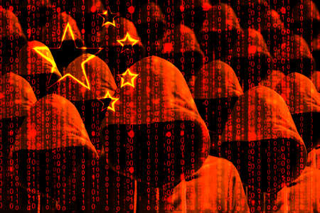 Group of hooded hackers shining through a digital chinese flag cybersecurity concept 版權商用圖片