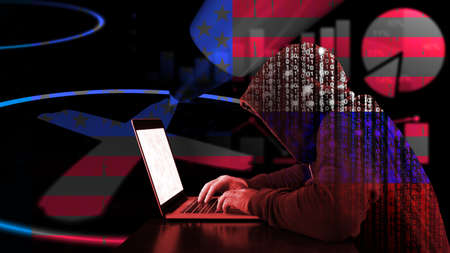 Russian hacker with binary hoddy typing on a laoptop in front of a ballot paper and charts in us flag texture election manipulation concept Standard-Bild