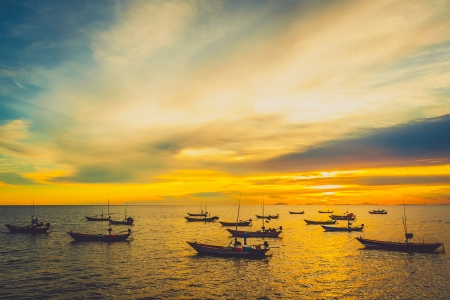 Fishing boats at sunset in Chantaburi, Thailand photo