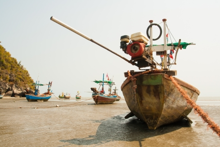 Small fishing boats on sand photo