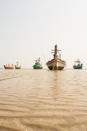 fishing ship: Small fishing boats on sand Stock Photo